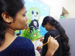 17 Girls painting mural