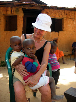 Edie holding village children