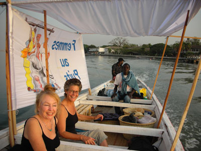 Catherine, Vijali, Boniface, Honré in our pirogue with banner