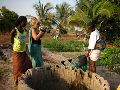 Vijali filming women at the well
