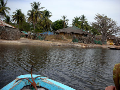 Approaching a traditional village in our pirogue