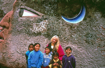 banner_world_wheel_sculpture_with_peguche_children_-_equcador