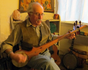 Peter playing the damnyen, the national banjo-lute of Tibet.