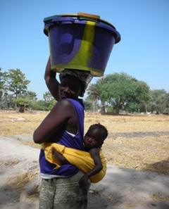 Senegalese mother and child with potable water